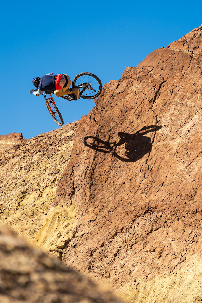 Kirt Voreis launches an inward table on a rock quarterpipe in the California desert.