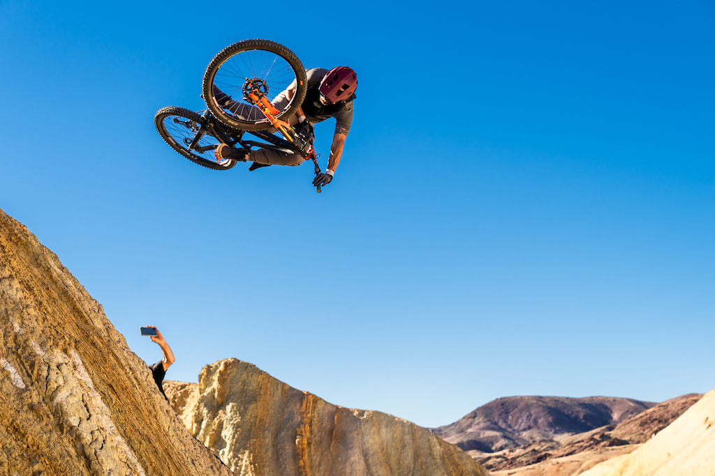 Kirt Voreis launches table in the California desert while Matt Collins films him.