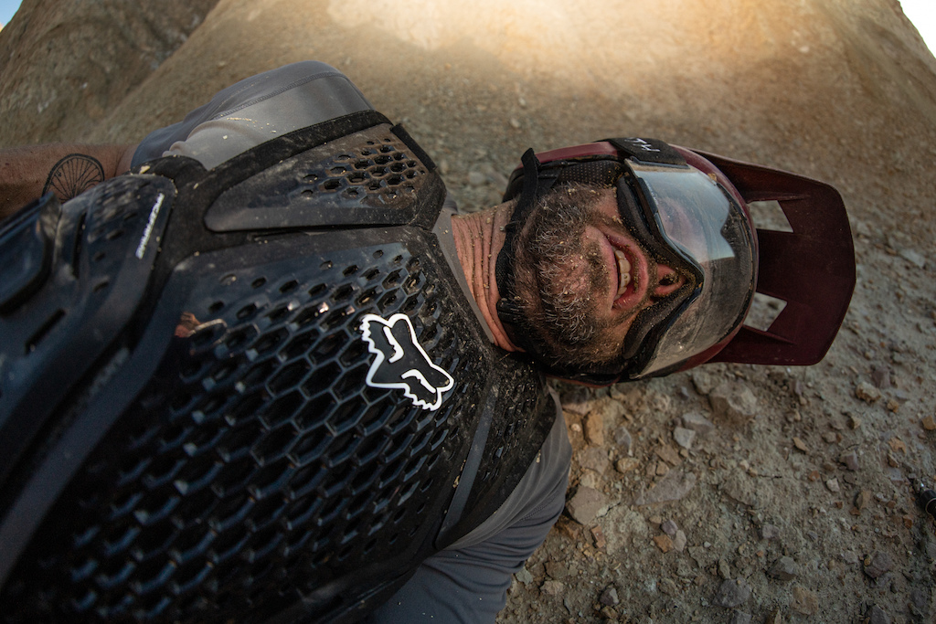 Kirt Voreis relaxes in the dirt for a minute after a crash on his mountain bike.