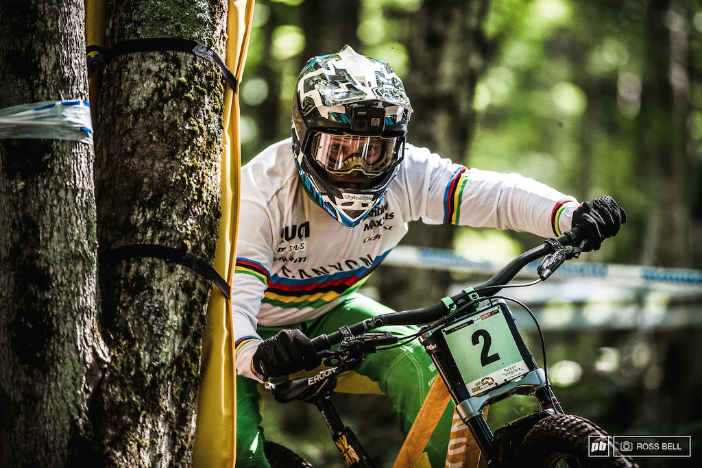Kye A'Hern keeping it tight to the trees in the World Champs jersey he won the previous weekend in Mont Sainte Anne.