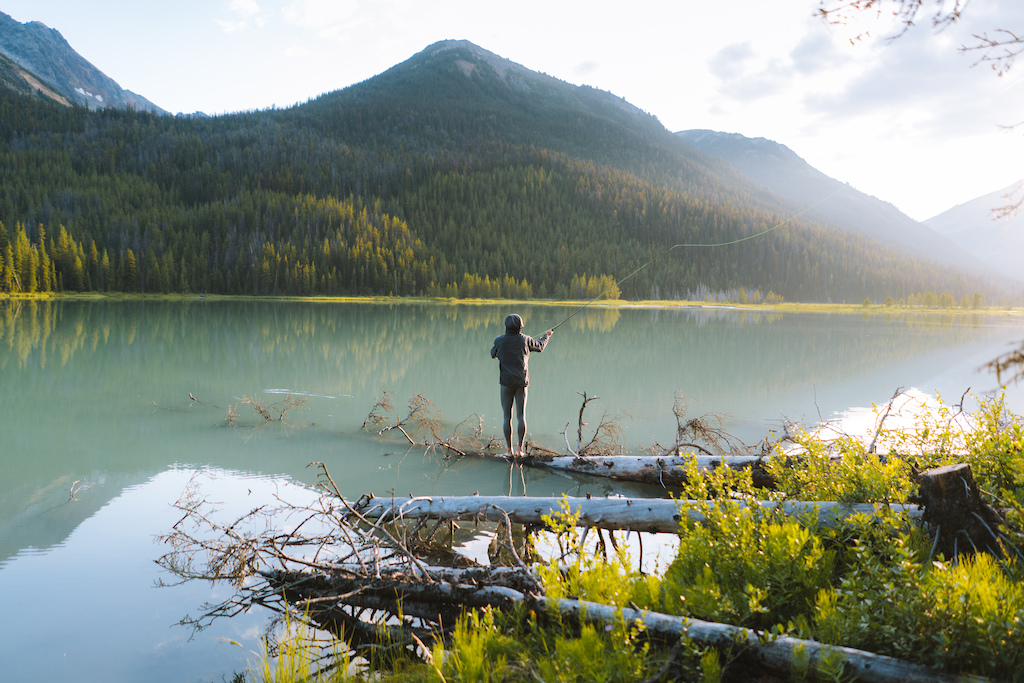 Spencer Wight passing the time on Trigger Lake at sunset.