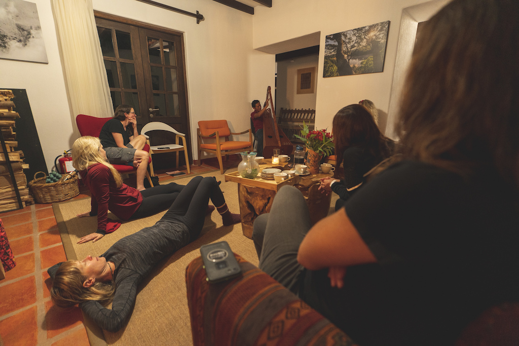 Relaxing and enjoying a local Andean harp private concert