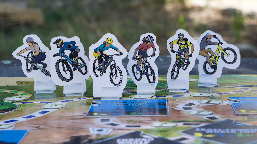 The SEND IT game riders L to R Dirt Jump Delilah Downhill Derek Enduro Elsa Cross-Country Carrie Singletrack Sammy Trials Terrance. SEND IT is now available on Kickstarter. Reserve your game now https www.senditboardgames.com kickstarter