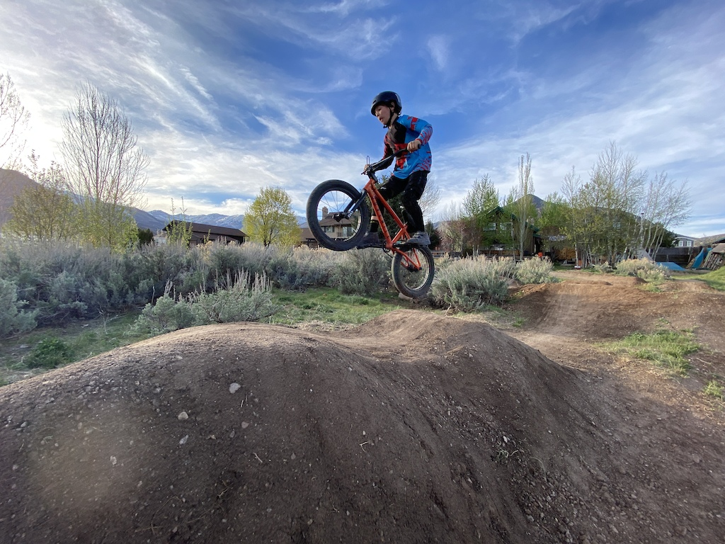 Owen jumping on the pumptrack.
