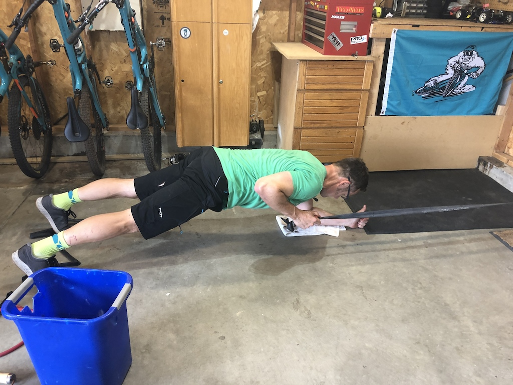 Plank with tube pulls
