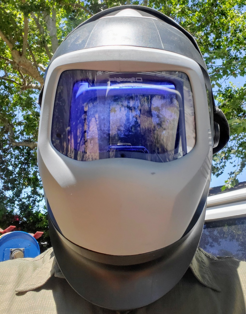 My gucci level hazardous environment welding hood. 9100XXi lens with extended head cover, PAPR Adflo filter and soon to add an extended neck protector. Super clear and very heavy duty.