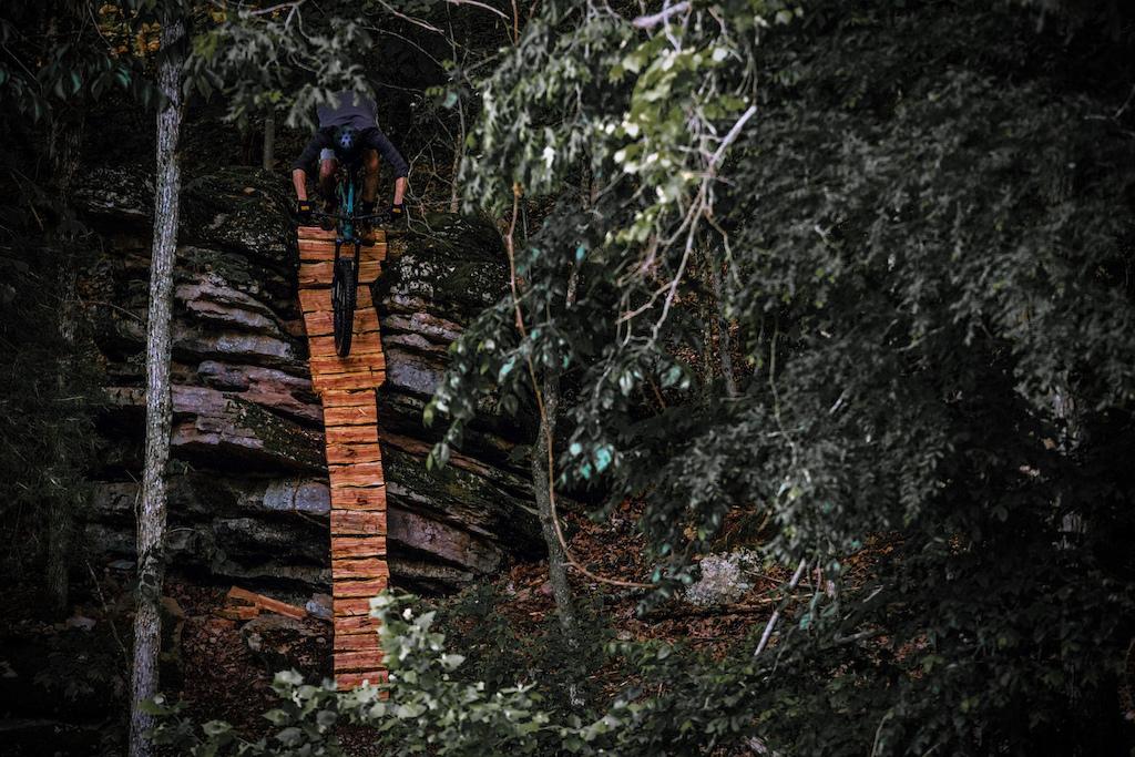 Dropping into the steep hand split cedar ladder bridge I built - self shot