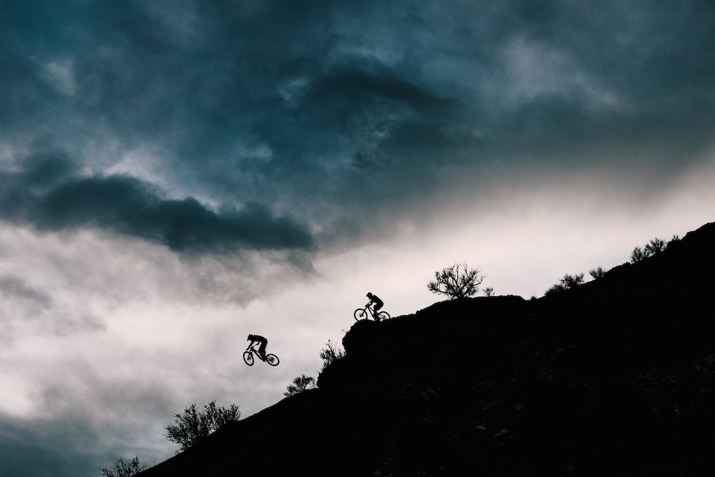 Cam McCaul chases after his brother on a rocky ridge in Utah.