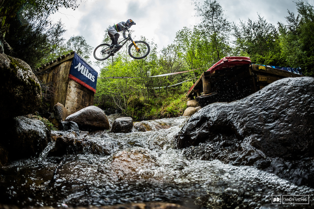Loic Bruni over the river gap as more water rained down on him from above. There was no avoiding moisture last year.