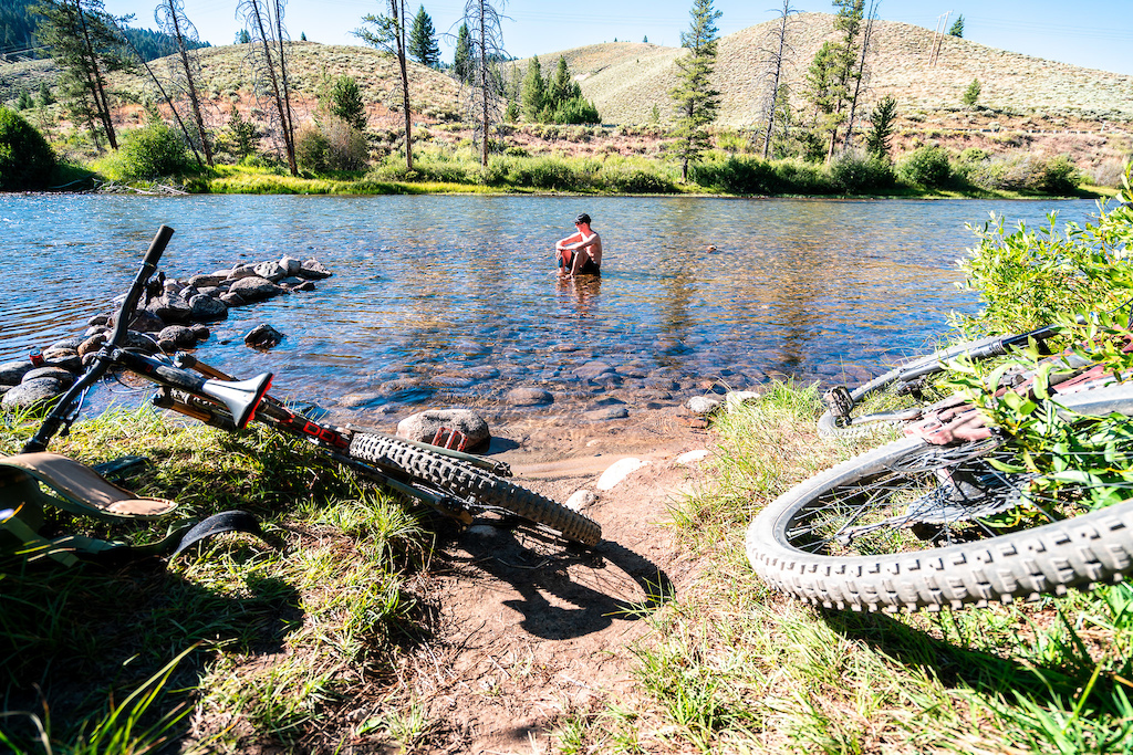 A soak in the river with a cold beer is the perfect way to end a long ride.