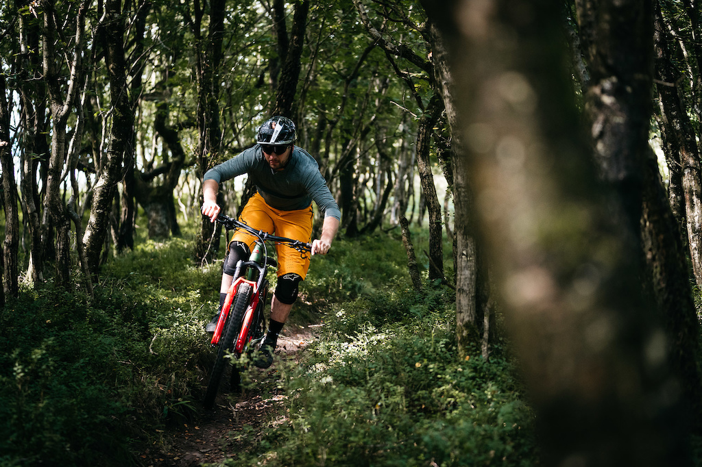 The UK influenced Merida Big.Trail 600 being ridden on the trails that inspired its creation.