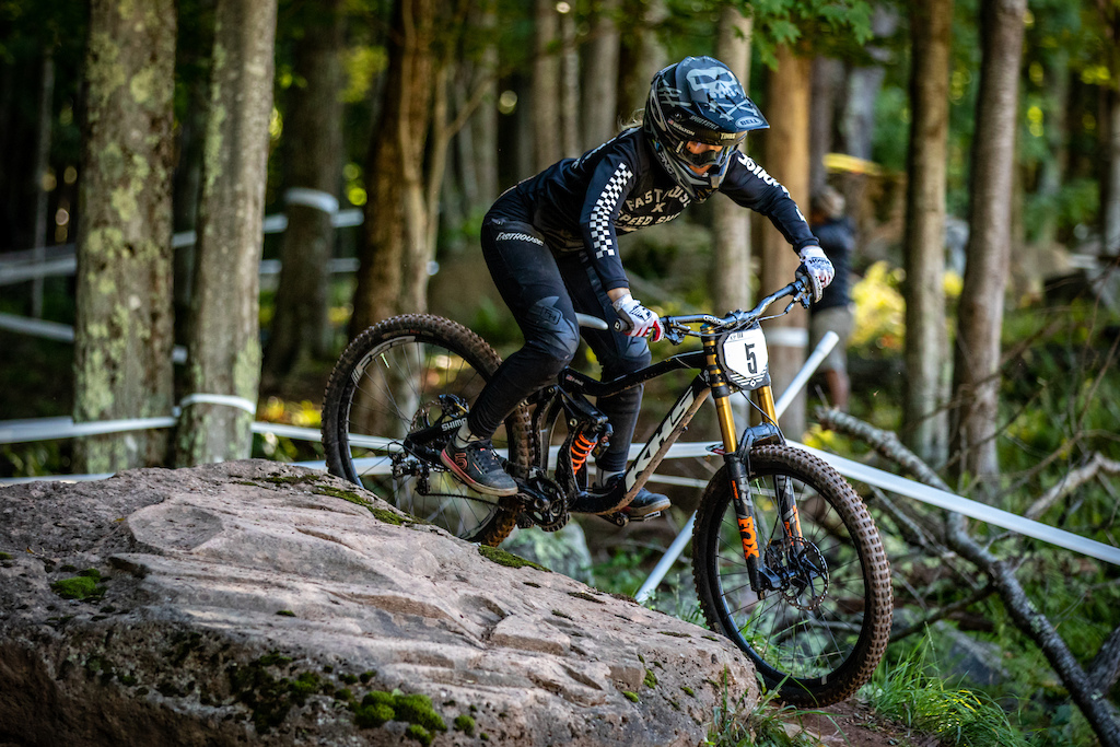 KHS Pro MTB team rider Kailey Skelton riding around a big rock at the DH finals in Snowshoe W.V.