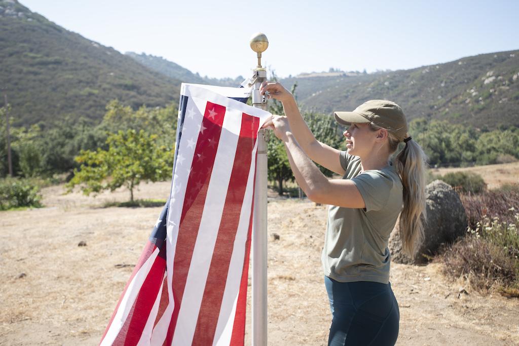 Rachel Strait putting up the American Flag