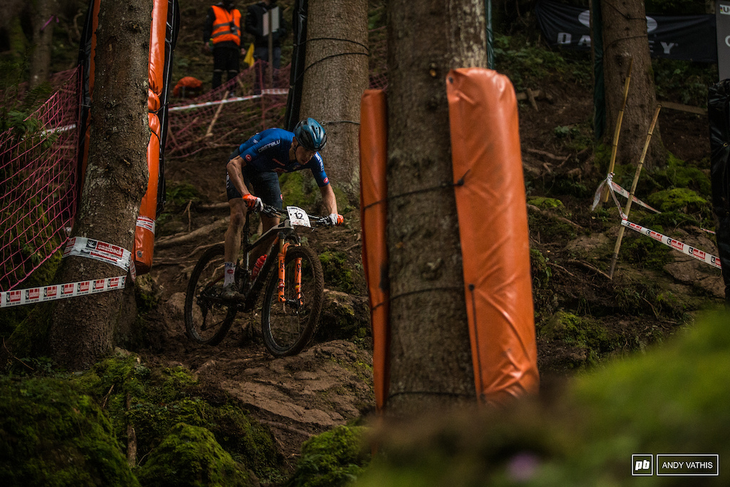 Over the big roots and boulders is Luca Braidot who went fourth today.