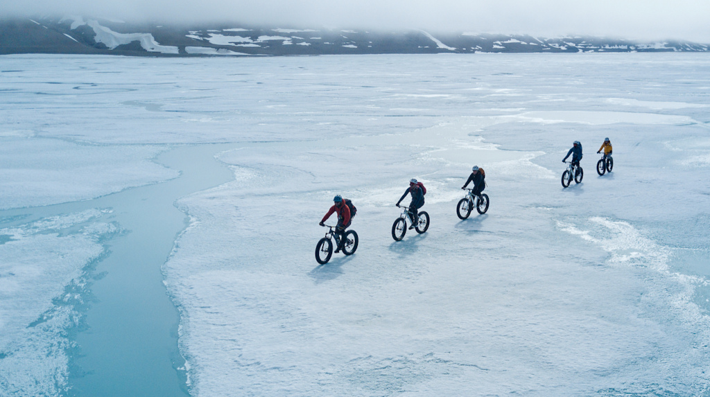 Biking on the Arctic ocean floe edge of Somerset Island about 10km from Arctic Watch Wilderness Lodge