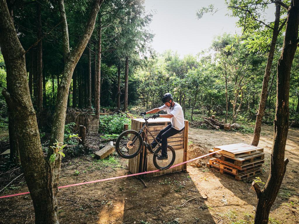 Tomomi rides his bike on the slackline