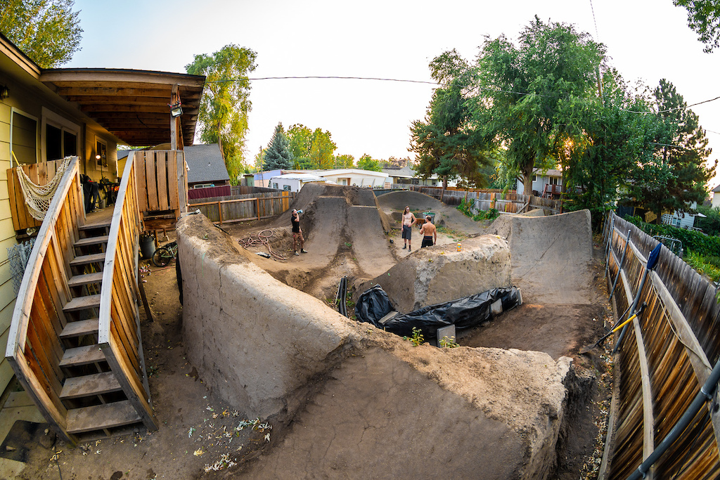Jason Schroeder and Austin Smith ride the dirt jumps in Austin s back yard in Boise Idaho