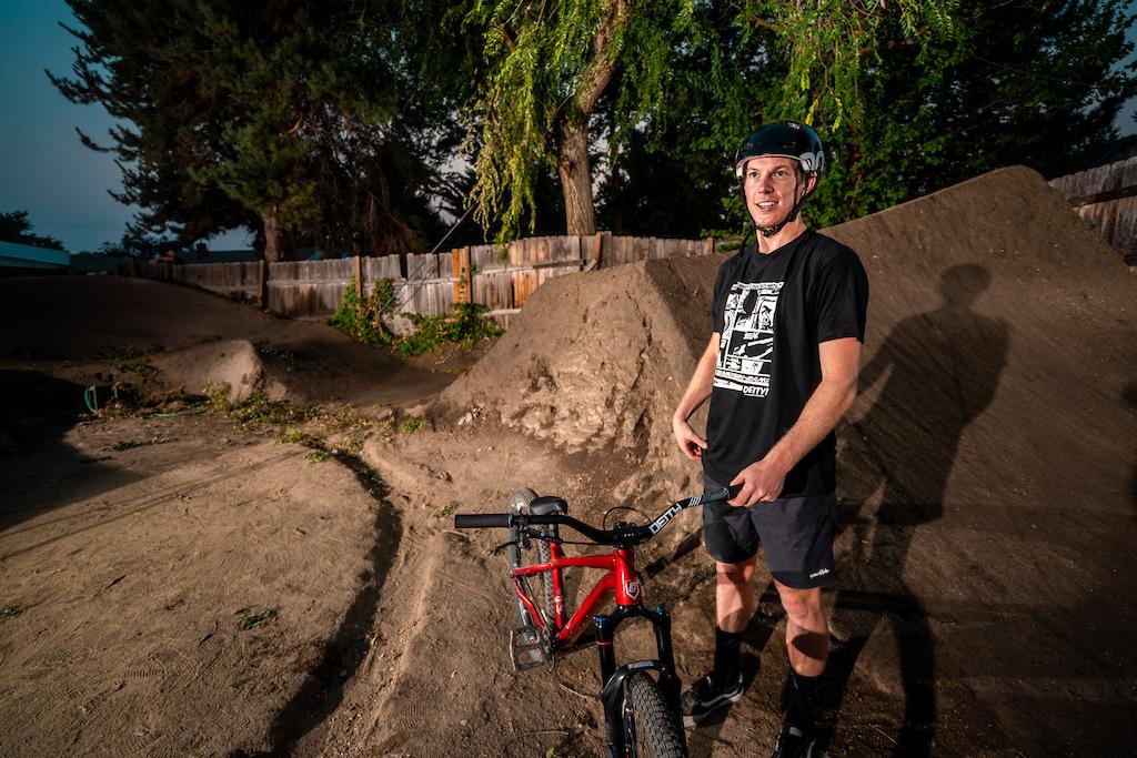 Jason Schroeder rides the dirt jumps in Austin Smiths back yard in Boise Idaho