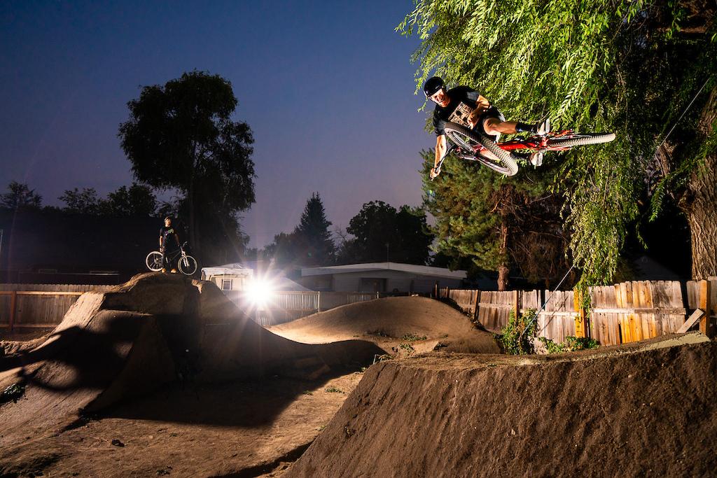 Jason Schroeder rides the dirt jumps in Austin Smiths back yard in Boise, Idaho