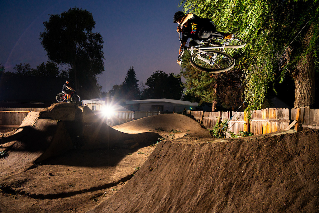 Austin Smith rides the dirt jumps in his back yard in Boise, Idaho