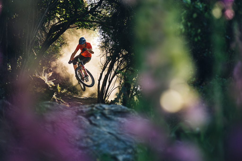 Conor tweaks out of the dust and into one of the tech black forest trails.