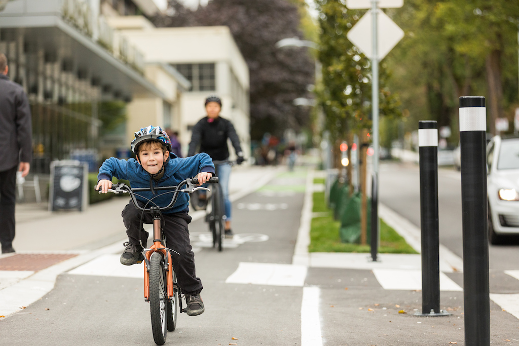 Youth riding in a bike lane