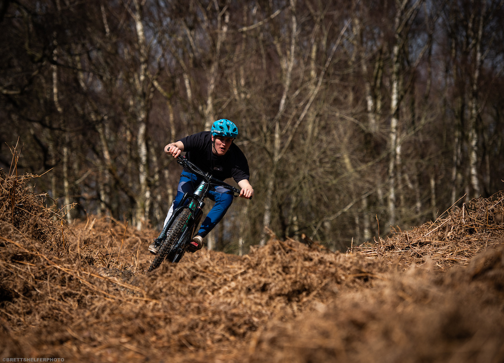 Josh coming in hot tearing up the loamy turns like a boss .