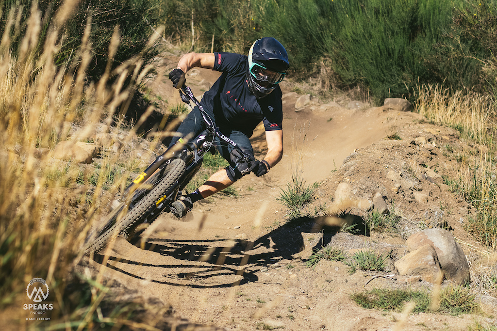 Charlie Murray rolling through buffed berms on the first stage of day 2.
