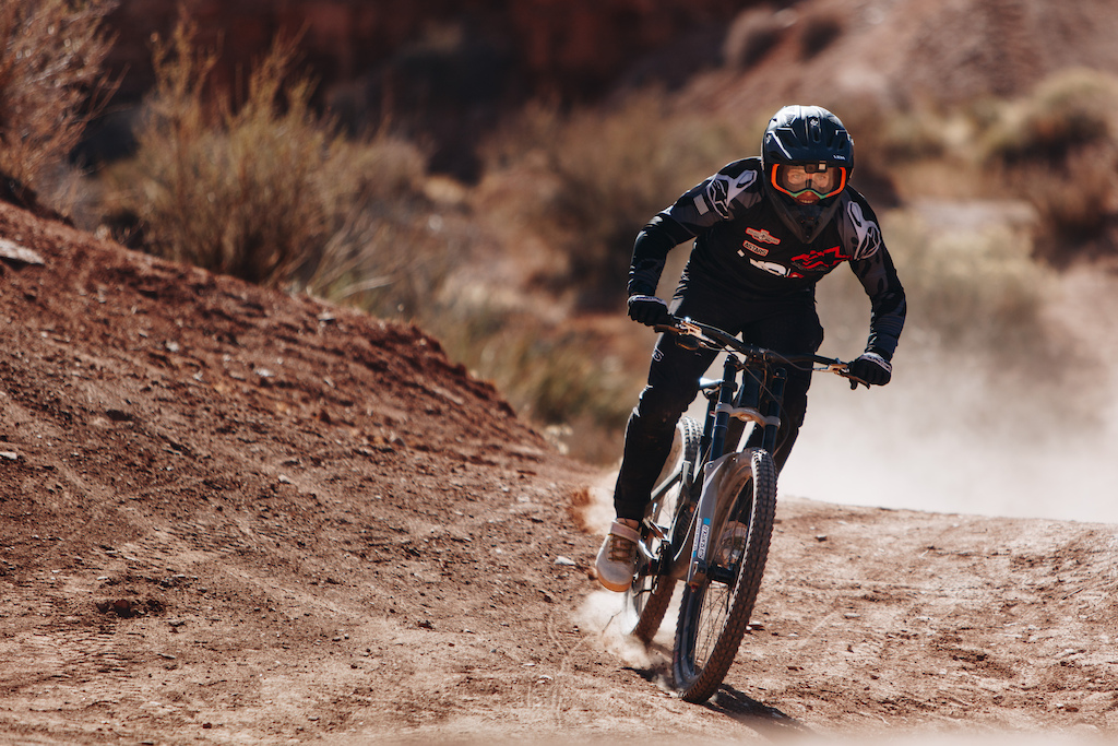 While he may not have been on a world cup race track Mick looked plenty comfortable in the desert and he threw down a couple very quick runs on some of the many ridges. Take a guess how fast he got down the 2015 Rampage site