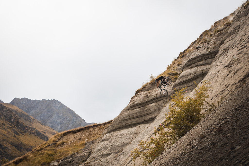 Ben Lang sending himself down a steep scree cliff for the shot.