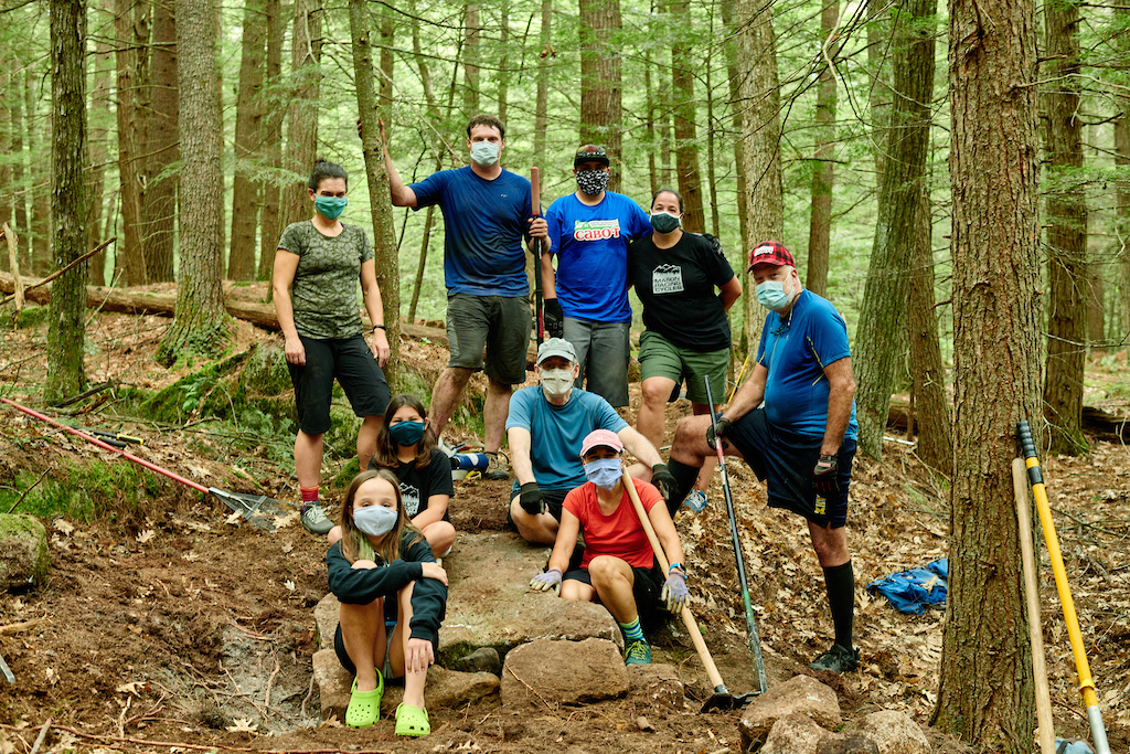 Trail work on a new Upper Valley Mountain Bike Association trail sponsored by a Cabot Cheese through a naming grant underwritten by Vermont Mountain BIke Association. Photo By Bear Cieri