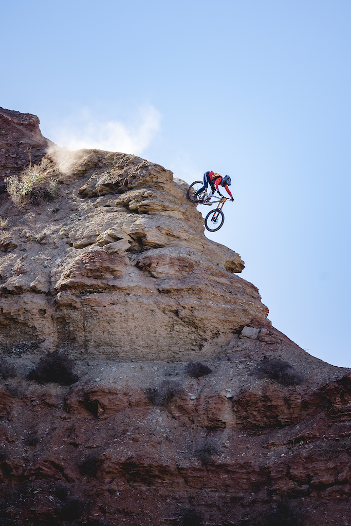 Vaea Verbeeck rides a steep rock roll on the ridge at Red Bull Formation in Virgin Utah USA on 31 May 2021