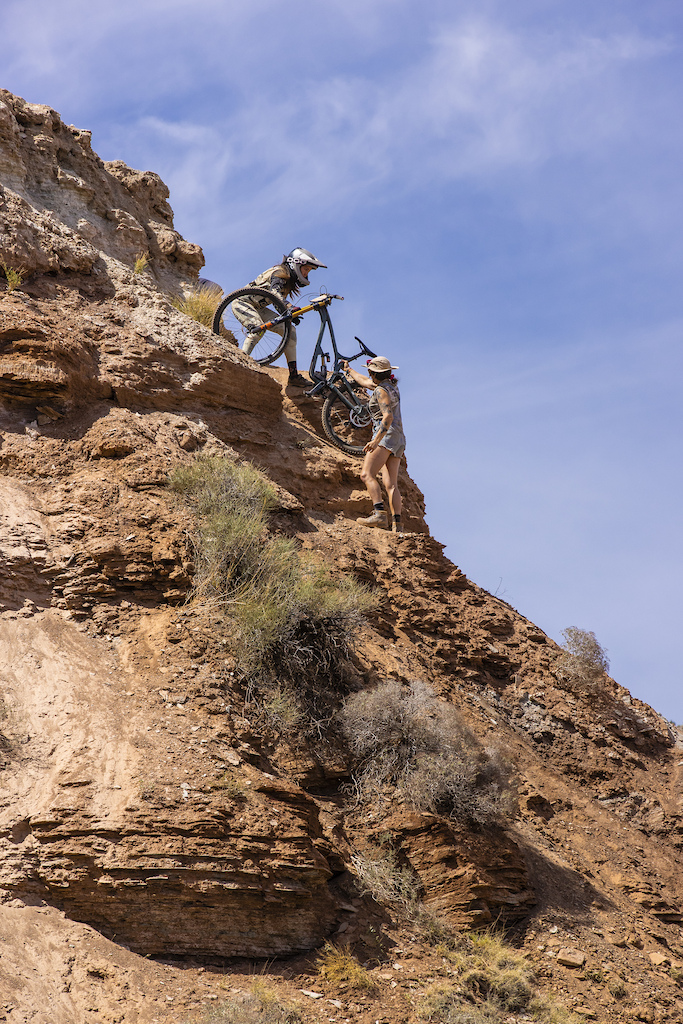 Blake Hansen passes Cami s bike up to her at Red Bull Formation in Virgin Utah USA on 29 May 2021.