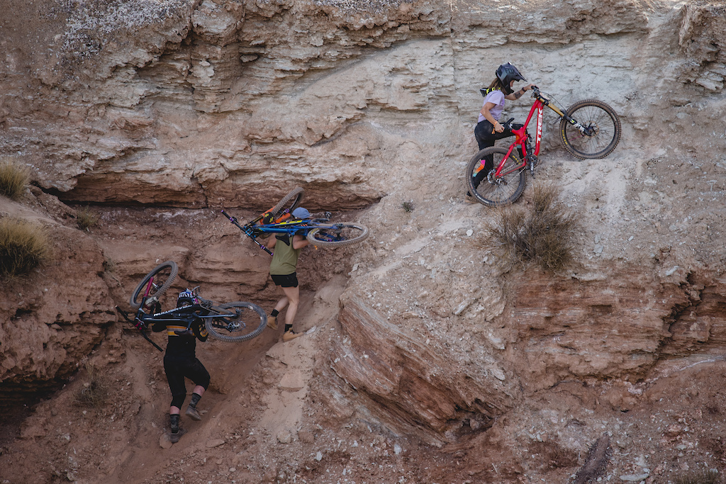 Hannah Bergemann Michelle Parker Vinny Armstrong hike bikes up the venue on ride day 1 at Red Bull Formation in Virgin Utah USA on 29 May 2021