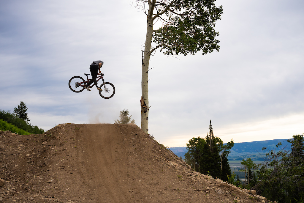 Unknown rider takes off at the bottom of Deer Jumps.