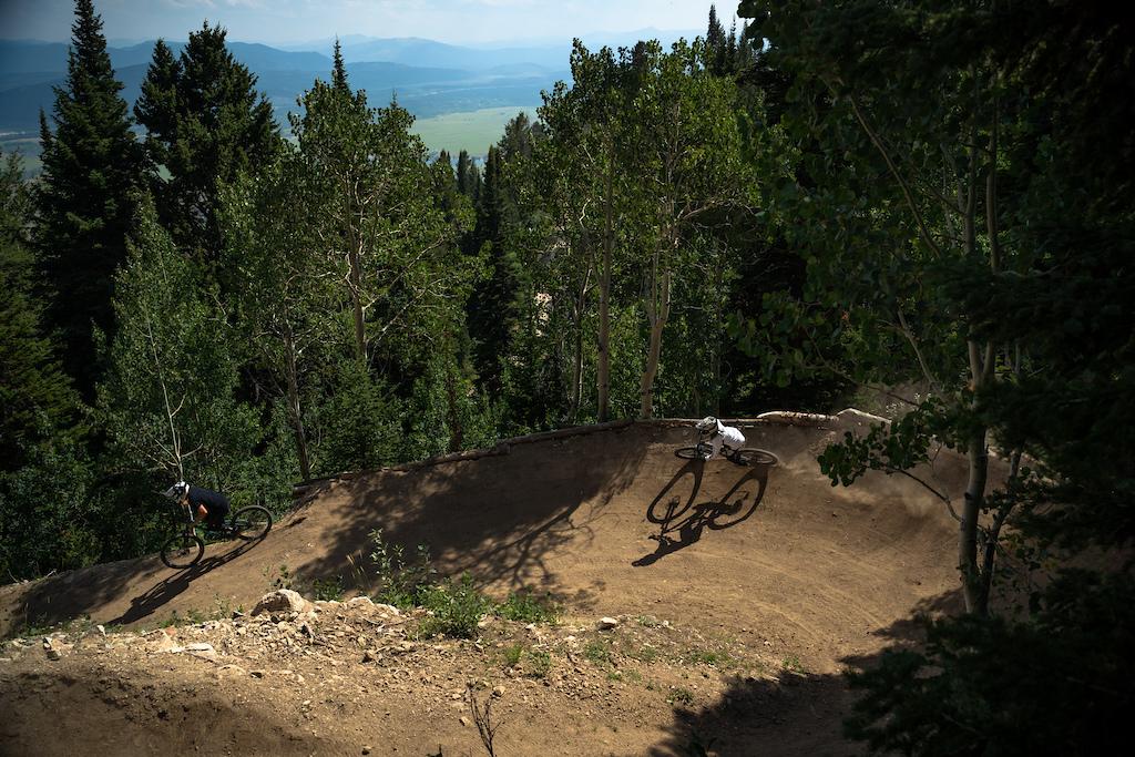 Nick Clark and Kai Jones on the Deer Jumps berms.
