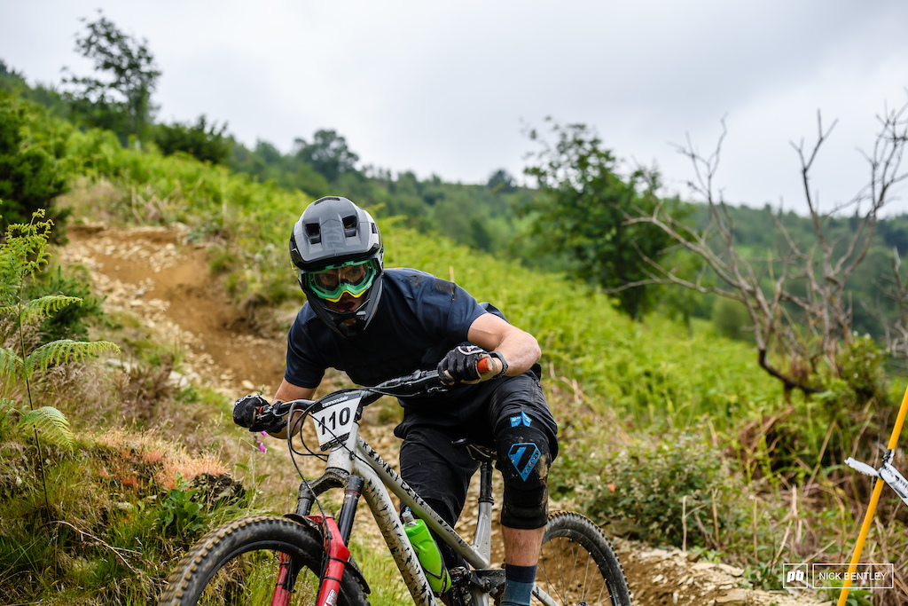 Ollie Mant getting it sideways on his way in to a tight switchback on stage 4.