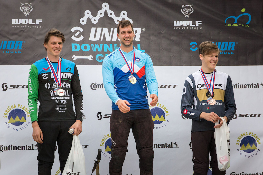 Elite men podium at 2021 Downhill Sorica round 1 of Unior Downhill Cup and Slovenian National Championships race. From left Jure abjek Luka Berginc and an Pir . Photo by Marko Obid.