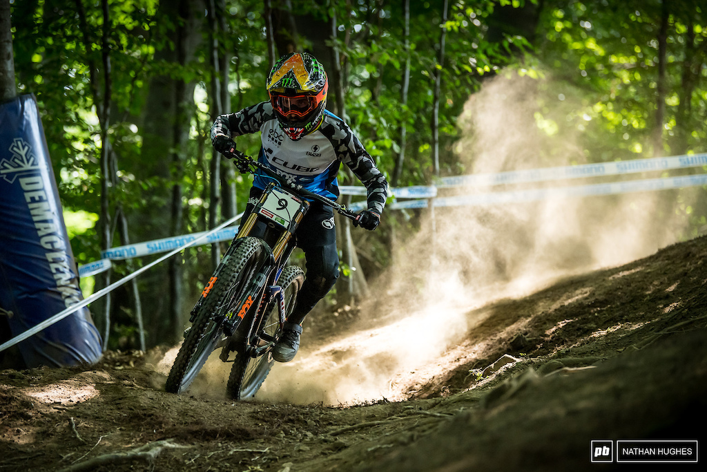Danny Hart full throttle into the first compression in the top woods.