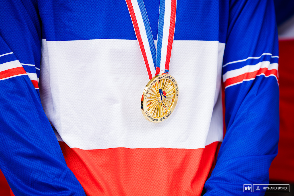 French Champion colos and medal.