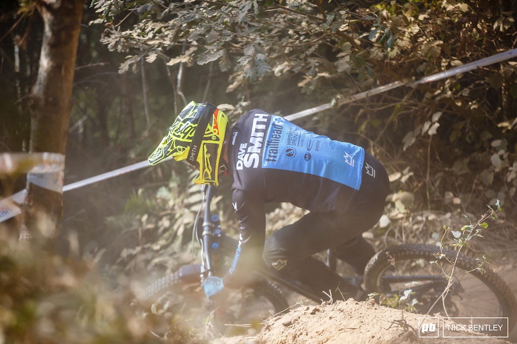 Dave Smith kicking up the dust as he carves his way through the Caersws turns