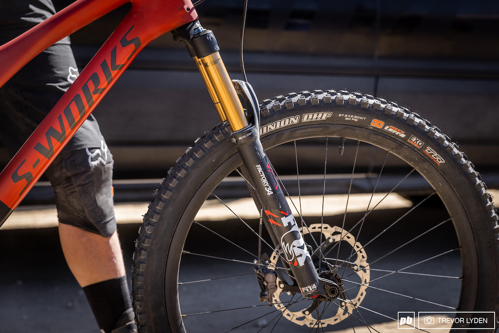 Cody opted for a smaller lighter fork for racing dual slalom. This Fox Factory 34 has been dropped to feature 130mm of travel and he s running around 130psi with nearly maxed out spacers. For dampening he keeps it in the middle setting and calls it good.