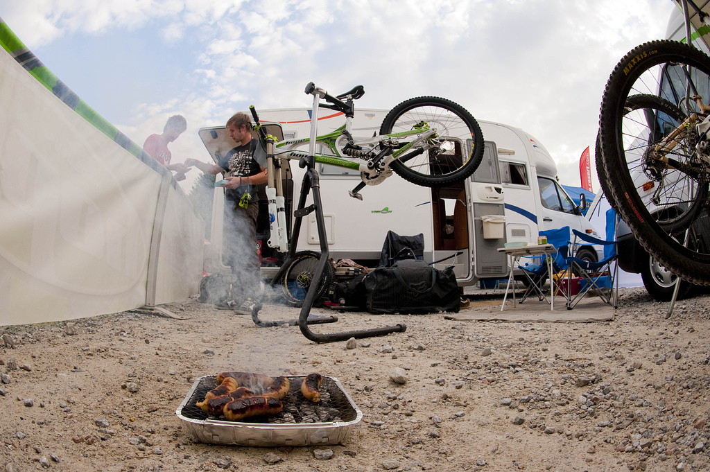 The privateer pits are a large part of the atmosphere at Fort William. Here's Thomas Braithwaite enjoying the classic privateer delicacy, charred sausages on a portable BBQ.