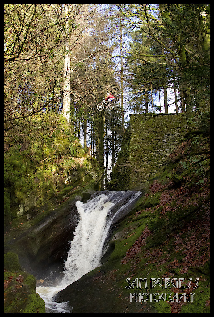 25 foot river gap in Mid Wales. Rider: Olly Davey. Photo by Sam Burgess