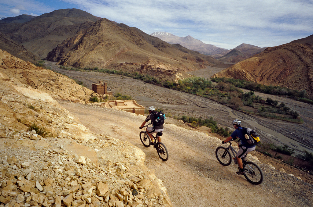 <span style='font-size:12px'>Our climb up from Toundoute started easy, surrounded by mind blowing scenery. Three hours later it had toughened up to the extent that the scenery had become a sweat-filtered blur.</span><br><br>We spin into the village of Telouet and pull up at the gite d'etape in darkness. It has been a surreal start to our seven day ride, pedaling onwards into the night with nothing but wilderness ahead. We're left buzzing from the experience as we chew local almonds and sip