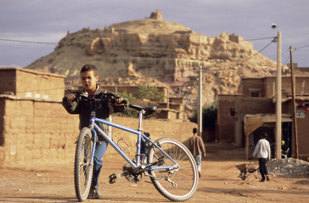 <span style='font-size:12px'>Hitting the plains near Ouarzazate we came across bikes -cheap, oversize Chinese made machines that are too heavy. The local kids don't care about weight though. To a kid, a bike is a bike, anywhere. That's the beauty of them.</span><br><br> It's not your usual way to undertake a bike test, but an understandably common one nonetheless. Reaching forward with leathery, dirt-engrained fingers, the man taps the downtube of my Commencal and smiles with crooked teeth at the resoundingly solid 'ting' that echoes down through its frame. 'Ah, good, good' he says before going on to perform the same quality-assessment on Guillaume's Specialized Enduro and then Mike's Stumpjumper. In a fleeting moment, inside a Marrakech bus station while enveloped by diesel fumes and the noisy revving of overworked engines, the test is complete and my bike is awarded the title of