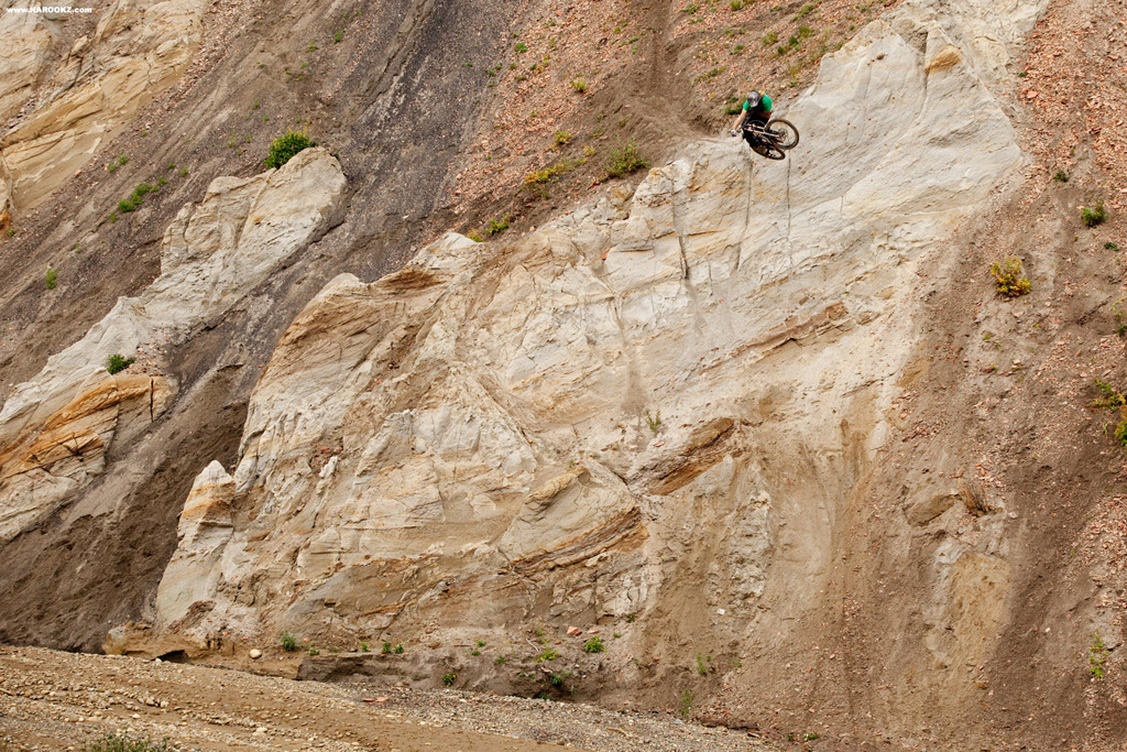One of the longer descents Kelly McGarry had on deck ended with a vertical wall, perfectly aligned for a step-down. All we had to do was buff in a run in and she was good to go. Nothing beats the usage of natural big mountain terrain.