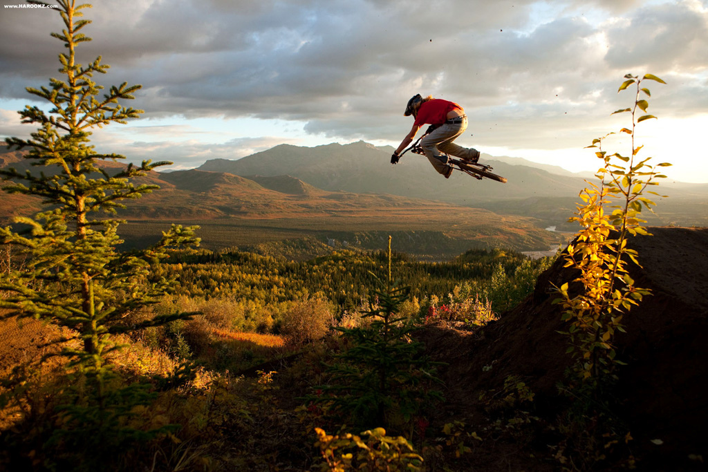 This was one of two golden light action sessions we were provided with. It's funny how the light always fires early on in a trip when we're out scouting and building the goods. The dirt in this zone is what we all dream of. Endless scoops of chocolate fudge with an absence of roots and rocks. It didn't take us long to build an A-line inspired line with chicanes connecting lofty jumps which overlooked the valley. Here's McGazza padding his air miles.