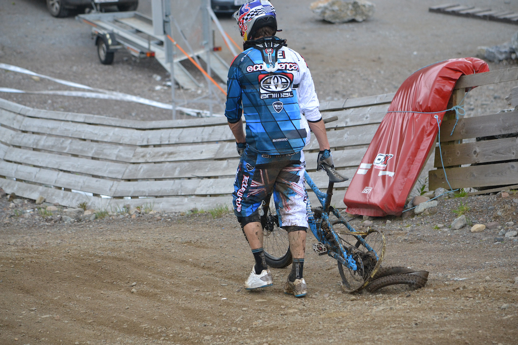 Broken bike. He is such a champ for finishing anyway!