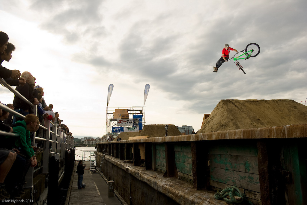 Luke Fulton with nice looking stretched out tailwhip on the second double on the barge.